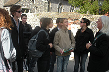 Image of tour guide with school kids